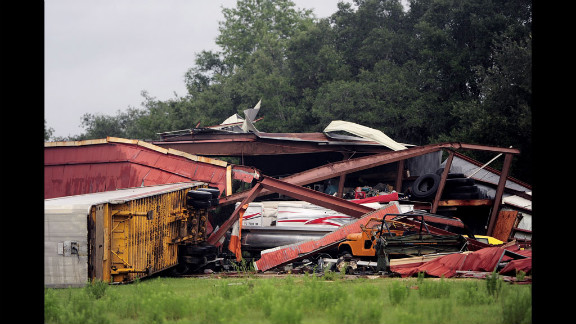 The aftermath of a tornado on Sunday, June 24, leaves a building destroyed and vehicles damaged in Lecanto. Tropical Storm Debby has wreaked widespread havoc in Florida, dumping nearly 2 feet of rain in some areas.