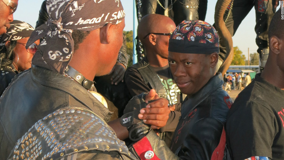 "Animal horns, as seen in the background, are an important fashion accessory in the Botswana heavy metal scene. ""We always have a symbol that represents Africa,"" says rocker Gunsmoke."
