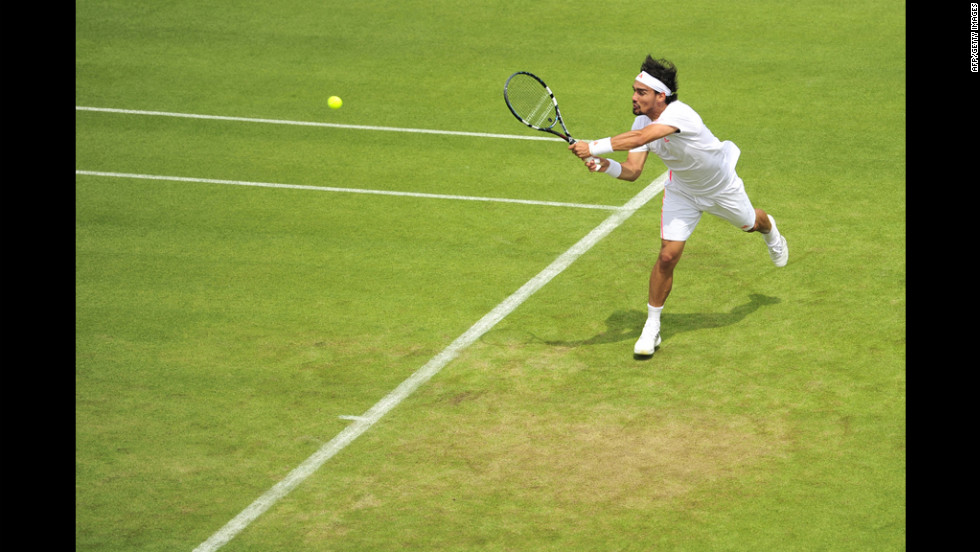 Fognini plays a shot against Llodra on June 25.