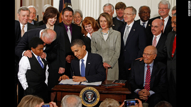 WASHINGTON - MARCH 23:  President Barack Obama (C) signs the Affordable Health Care for America Act during a ceremony with fellow Democrats in the East Room of the White House March 23, 2010 in Washington, DC. The landmark bill was passed by the House of Representatives Sunday after a 14-month-long political battle that left the legislation without a single Republican vote.  (Photo by Chip Somodevilla/Getty Images) *** Local Caption *** James Clyburn;John Dingell;Steny Hoyer;George Miller;Charlie Rangel;Harry Reid;Nancy Pelosi;Joe Biden;Victoria Kennedy;Marcelas Owens;Kathleen Sebelius;Barack Obama