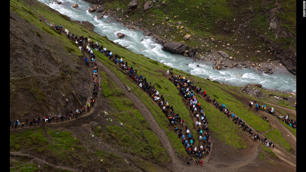Hindus make their pilgrimage Monday to the sacred Amarnath Caves, one of the religion's most revered shrines, in Baltal, Indian-administered Kashmir. More than 200,000 Hindu pilgrims are expected to take part in this year's two-month pilgrimage.