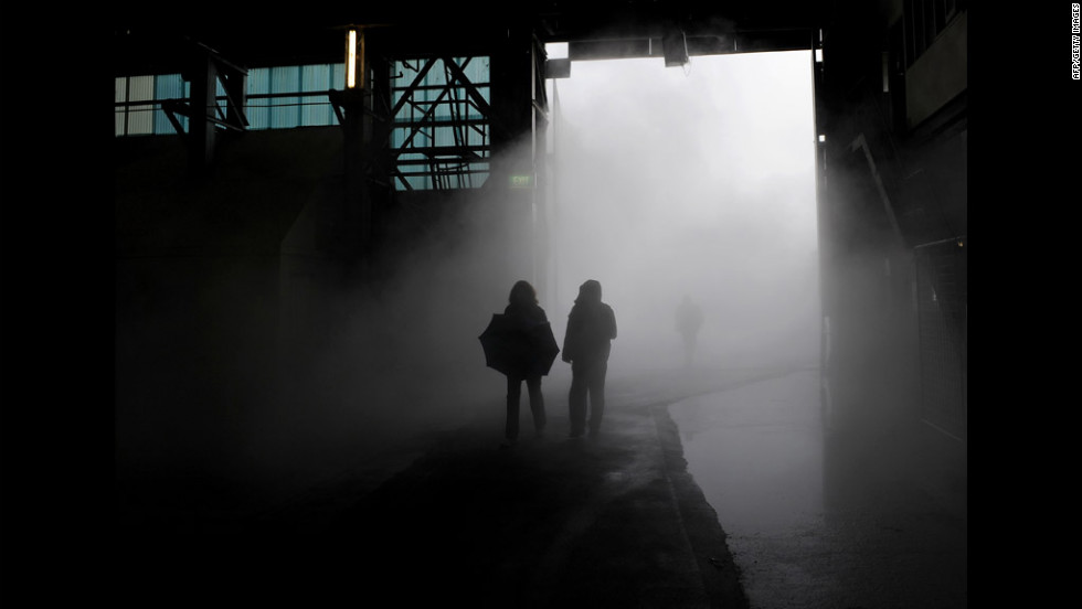 Members of the media walk through artificial fog, part of an installation by Japanese artist Fujiko Nakaya, Tuesday on Cockatoo Island near Sydney, Australia, during a preview of the 18th Biennale of Sydney.