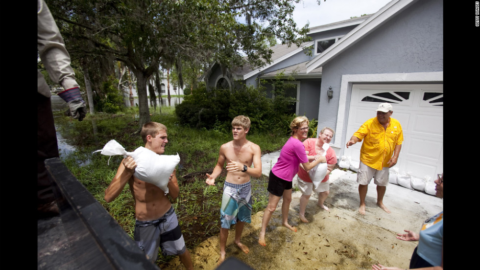 Residents of the Mill Run area ready their homes with sandbags in preparation of the continually approaching storm.