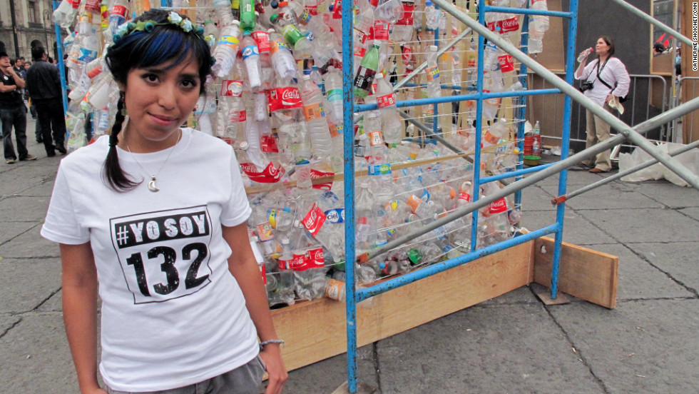 Selene Galindo Enriquez, 20, stands beside an art installation that she and other youth protesters helped create in Mexico City.