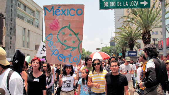 Selene Galindo Enriquez carries a handmade sign as she marches alongside other youth protesters in Mexico City. She said she plans to vote for the first time in Sunday's elections.