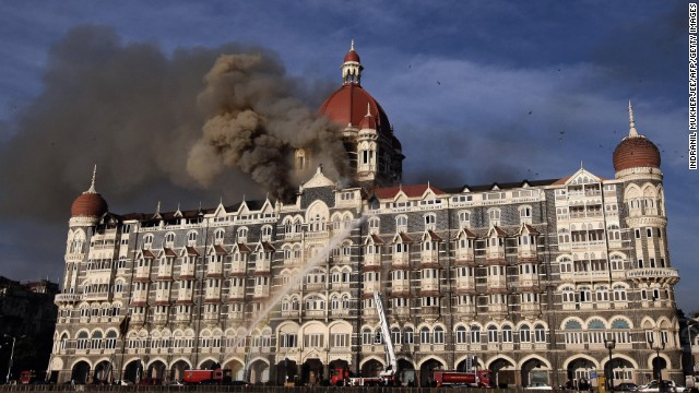 Firefighters try to put out a fire at the historic Taj Mahal Hotel in Mumbai on November 27, 2008.