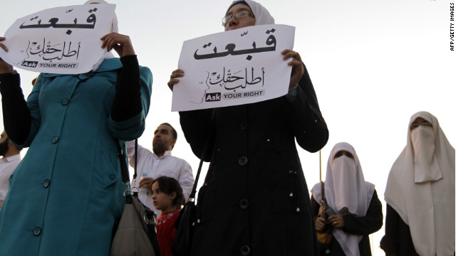 "Jordanian women hold up signs that say ""ask for your rights."""