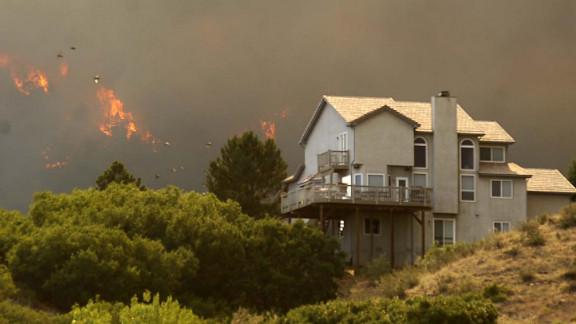 The Waldo Canyon Fire invades the Mountain Shadows neighborhood of Colorado Springs, Colorado, on Tuesday.