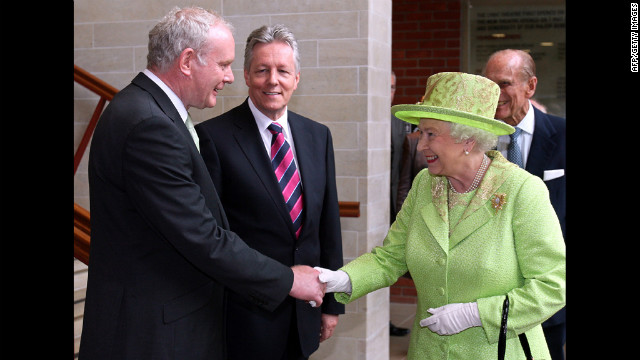 Britain's Queen Elizabeth II (2nd R) shakes hands with Northern Ireland Deputy First Minister Martin McGuinness (L) watched by First Minister Peter Robinson (2nd L) and Prince Philip (R) at the Lyric Theatre in Belfast, Northern Ireland, on June 27, 2012. Queen Elizabeth II shook hands with former IRA commander Martin McGuinness on Wednesday in a landmark moment in the Northern Ireland peace process, Buckingham Palace said. The initial handshake between the queen and McGuinness, who is now deputy first minister of the British province, took place away from the media spotlight behind closed doors in Belfast's Lyric theatre.  AFP PHOTO / PAUL FAITH/POOL        (Photo credit should read PAUL FAITH/AFP/GettyImages)