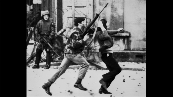 "A British soldier drags a Catholic protester on ""Bloody Sunday,"" when British paratroopers shot and killed 13 Catholic civil rights marchers in Londonderry, Northern Ireland, on January 30, 1972. Shortly after, the Irish Republican Army declared that its immediate policy was ""to kill as many British soldiers as possible."""