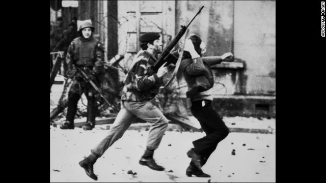 "LONDONDERRY, UNITED KINGDOM - JANUARY30:  A British soldier drags a Catholic protester during the ""Bloody Sunday"" killings 30 January 1972 when British paratroopers shot dead 13 Catholics civil rights marchers in Londonderry. Shortly after, the Irish Republican Army (IRA) declared that their immediate policy was ""to kill as many British soldiers as possible"". Since the partition of Ireland in 1921, the IRA has fought for a complete withdrawal of British troops from Northern Ireland and a reunification of the island of Ireland. But it was in 1969, when civil rights marches flared into violence, that the old IRA split and the Provisional IRA was born. Around 3,500 people have died and almost 40,000 have been injured in sectarian violence involving the IRA and pro-British-rule unionist paramilitaries--the so-called loyalists.  (Photo credit should read THOPSON/AFP/Getty Images)"