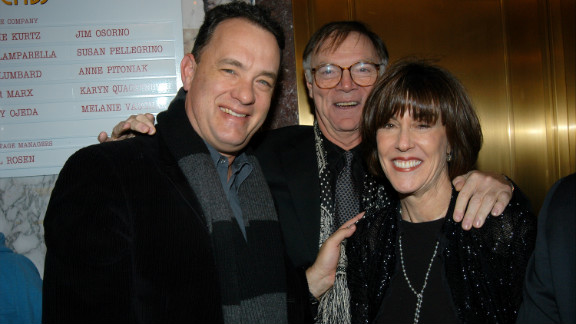 "Tom Hanks joins Ephron and husband Nicholas Pileggi in 2003 for the opening-night performance of her play ""Imaginary Friends."" Hanks starred in Ephron"