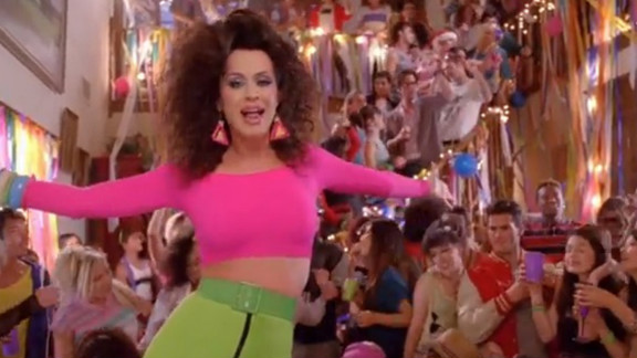 """Perry also wore a neon crop top in her """"Last Friday Night"""" music video."""
