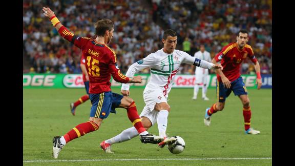 Sergio Ramos of Spain challenges Cristiano Ronaldo of Portugal