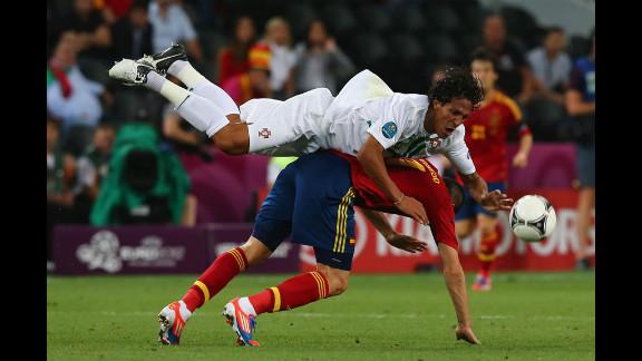 Bruno Alves of Portugal and Alvaro Negredo of Spain challenge for the ball.