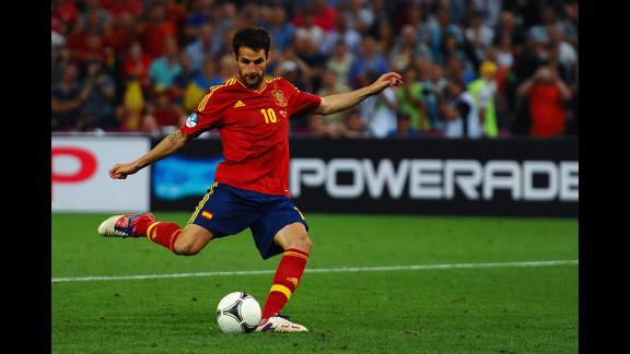 Cesc Fabregas of Spain scores the winning penalty.
