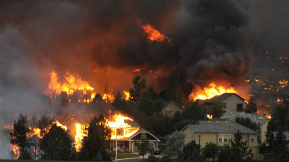 The Waldo Canyon fire spreads through a neighborhood in the hills above Colorado Springs on June 26. See more photos at The Denver Post.