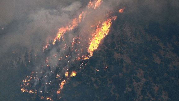 A portion of the Waldo Canyon Fire moves across a hillside above a subdivision west of Colorado Springs on Tuesday.