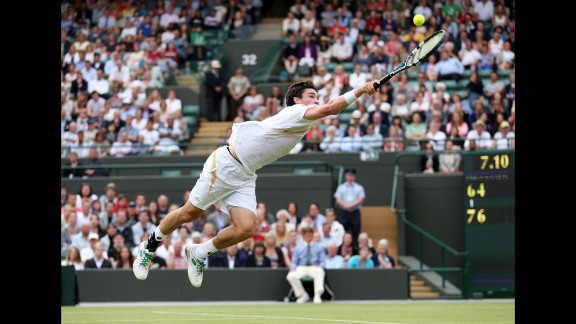 Jamie Baker of Great Britain dives for a backhand return during his first-round match against Andy Roddick of the United States on Wednesday, June 27, at Wimbledon.