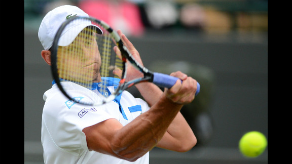 Andy Roddick plays a forehand shot during his match against Britain