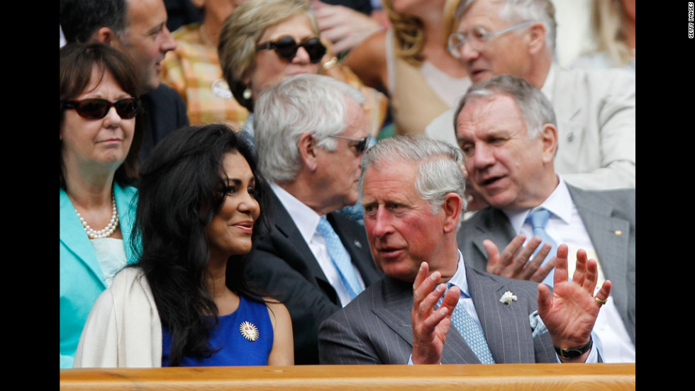 Prince Charles chats with Lady Winnie Forsyth on Wednesday as Roger Federer of Switzerland plays Fabio Fognini of Italy.