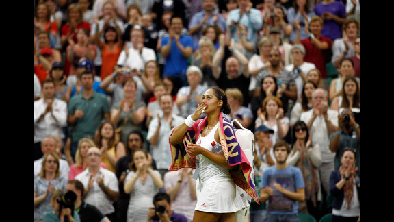 Tamira Paszek of Austria celebrates after beating Caroline Wozniacki of Denmark on Wednesday.