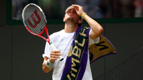 Mardy Fish of the United States reacts June 28 during his second-round match against James Ward of Great Britain.