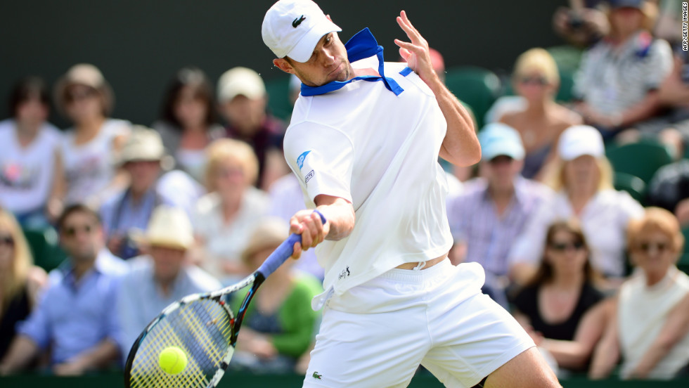 Andy Roddick of the United States plays a forehand shot during his second-round match against Bjorn Phau of Germany on June 28.