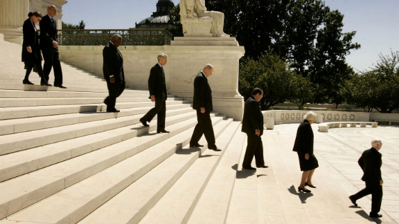 Justices file out of the Supreme Court building during funeral services for Chief Justice William Rehnquist on September 7, 2005. Following Rehnquist