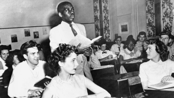 Brown v. Board of Education (1954): Nathaniel Steward recites his lesson surrounded by white classmates at the Saint-Dominique School in Washington. In Brown v. Board of Education, the Supreme Court ruled that it was unconstitutional to separate students based on race.