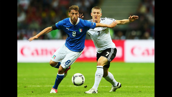 Claudio Marchisio of Italy and Bastian Schweinsteiger of Germany battle for the ball.