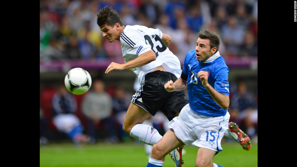 German midfielder Ilkay Guendogan vies with Italian defender Andrea Barzagli.