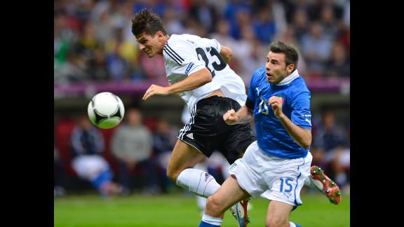 German midfielder Ilkay Guendogan vies with Italian defender Andrea Barzagli.