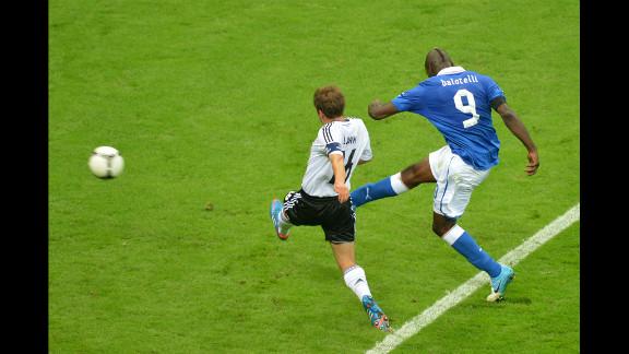 Italian forward Mario Balotelli shoots to score his second goal of the match.