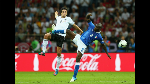 Mario Balotelli, right, of Italy battles for the ball with Mats Hummels of Germany.