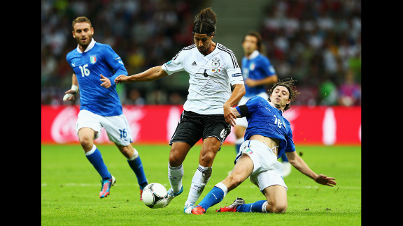 Sami Khedira of Germany, in white, battles for the ball with Riccardo Montolivo of Italy.