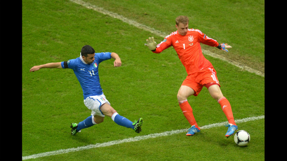 Italian forward Antonio Di Natale vies with German goalkeeper Manuel Neuer