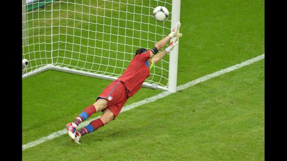 Italian goalkeeper Gianluigi Buffon fails to stop a penalty.