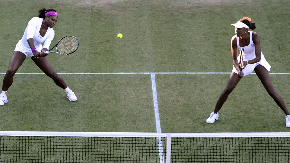 U.S. players Serena Williams, left, and Venus WIlliams in their first-round women
