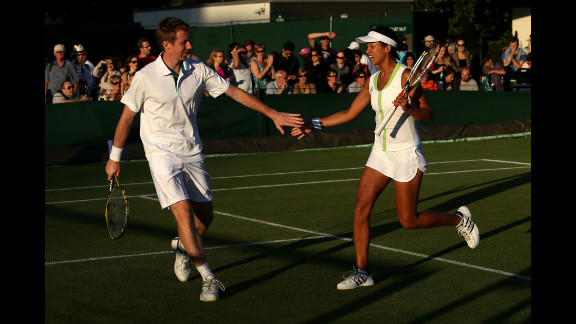 Jonathan Marray and Anne Keothavong of Great Britain during the mixed doubles first-round match against Paul Hanley of Australia and Alla Kudryavtseva of Russia June 28.
