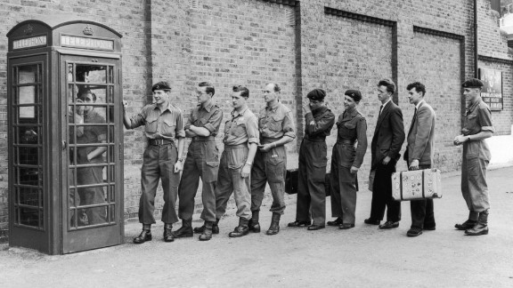 English soldiers call their loved ones after being told to prepare for duty in the Suez Canal Zone in 1956.