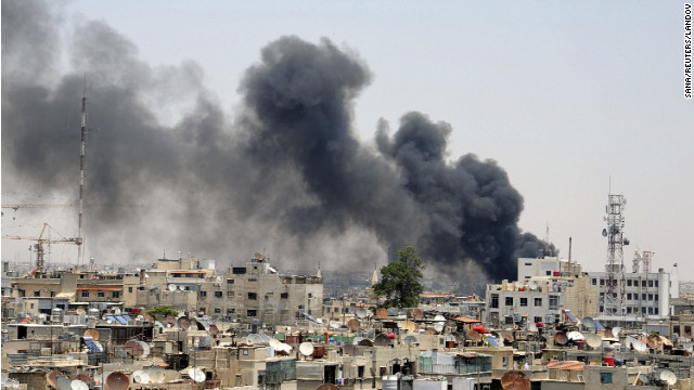 Smoke rises after an explosion Thursday near the Palace of Justice in central Damascus, Syria.