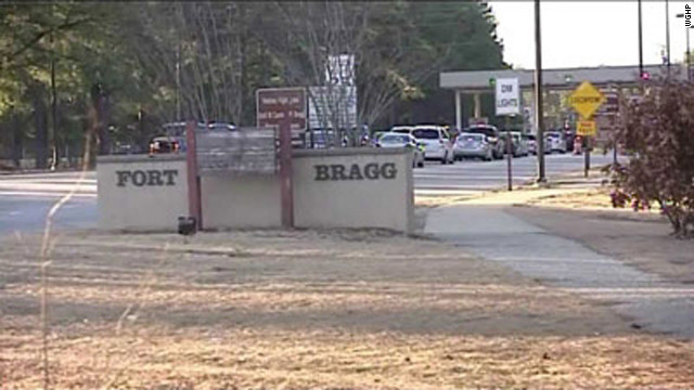Officials say a man shot an officer to death before shooting himself at Fort Bragg on Thursday. A specialist also was wounded.