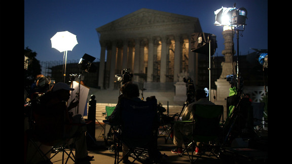 Reporters and camera crews begin waiting early Thursday outside the Supreme Court in anticipation of the court