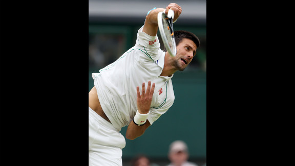 Novak Djokovic of Serbia serves against the Czech Republic