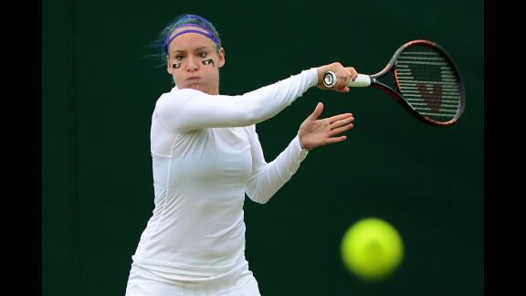 U.S. player Bethanie Mattek-Sands warms up before her second-round women