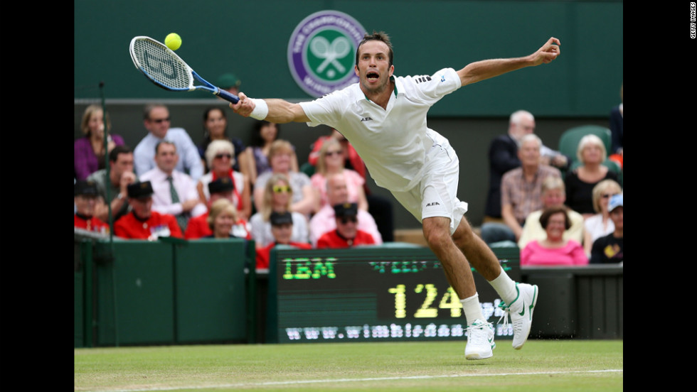 Stepanek reaches out to make a forehand return against Djokovic on Friday.