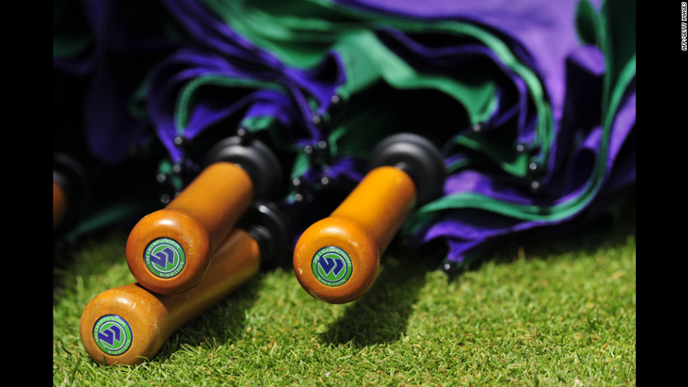 Umbrellas are on hand Friday during the Wimbledon Championships.
