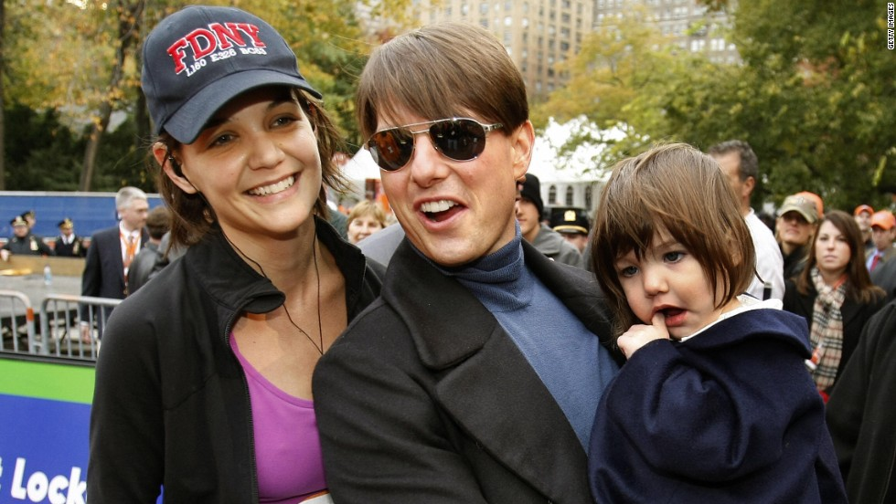 Cruise and daughter Suri cheer Holmes on when she ran the New York City Marathon in November 2007.