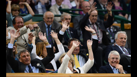 """People in the Royal Box at the All-England Club take part in a """"wave"""" on Friday."""